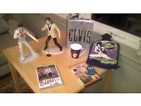 Elvis memorabilia two figurines,dvd's,mug,keyring,75th anniversary book and hot water bottle.Bargain