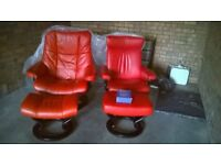 2 X RED LEATHER EKORNES RECLINING ARMCHAIRS WITH FOOTSTOOLS.