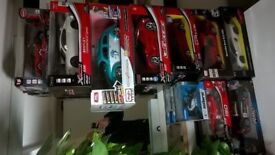 Nine radio-controlled toy super cars and one motorbike brand new boxed central London bargain