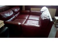2x 2seater red leather sofas