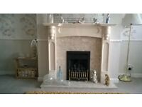 Marble effect fire surround and hearth.
