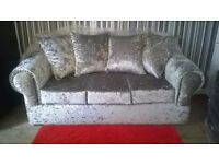 Sofas 3&2 seaters in silver crushed velvet, brand new and unused, can deliver if interested.