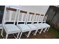 6 Solid white painted chairs also have rocking chair