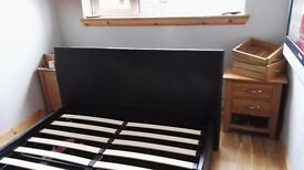 Faux black leather ottoman double bed