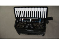 ROLAND FR 3X V-ACCORDION ( 3CD Disc instructions , a flash drive with extra sets, A Gig Bag.