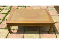 Rattan topped coffee table