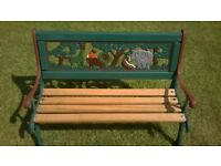 Child's wrought iron and wood garden bench.