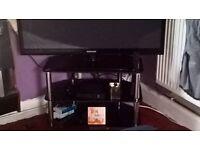 3 tear black glass tv stand