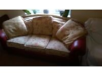 Large 3 seater sofa, with red leather arms.