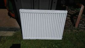 Double radiator with wall bracket