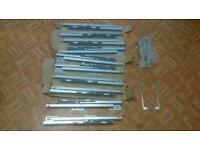 5 sets of slow close kitchen drawer runners and 12 kitchen cupboard handles