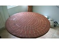 Large tiled table (terracotta) and cast iron. Hand made Cost £300 new. £40 bargain