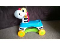 Fisher Price Musical Ride-on Zebra