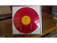 4 x coloured vinyl records..in silver coloured frames..