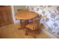 DROP LEAF PINE TABLE WITH TWO SPINDLE BACK CHAIRS