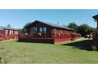 Discounted lodge for sale at Yaxham Waters Norfolk 4/6 berth lakeside view nr Norwich rural location