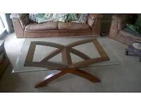 Quality Cofee Table. Glass top, dark wood base