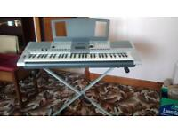 Yamaha Electric Keyboard with Stand and Music Books very good Condition plus box .