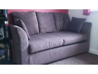 Brown chenille sofabed.