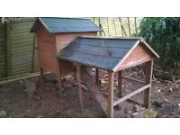 Chicken Hutch/hen house, wood with felt tile roof.