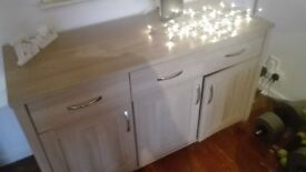 Solid unit with drawers and cupboards