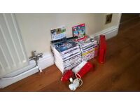Red Nintendo Wii . Two remotes and 26 Games very good condition