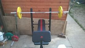 weight bench and full Olympic weight set
