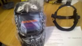 NEW AUTO DARKENING WELDING MASK AND AUTO CHARGE NEW IN THE BOX