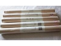 5 unopened rolls Laura Ashley Natural coloured wallpaper.