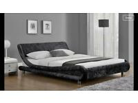 Black crushed velvet sleigh double bed.
