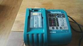 Makita fast charger does both batteries hardly used
