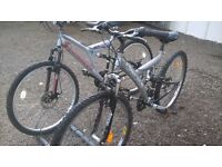 ADULT UNISEX MOUNTAIN BIKES 2 OFF SILVER CAN BE ADJUSTED TO SUIT MOST