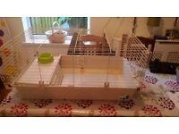 guinea pig cage with other items,