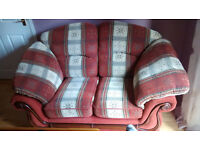 TWO SEATER SOFA IN CREAM AND TERRACOTTA PRINT - EXCELLENT CONDITION
