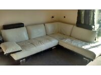 Very large white and black leather corner sofa