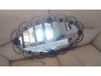 DECORATIVE OVAL WROUGHT FRAMED WALL MIRROR MEASURES 45CM X 75CM