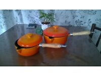 2 Orange Cast Iron saucepan with wooden handle