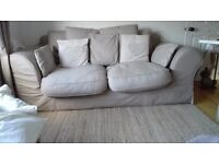 2 large loose covered sofas