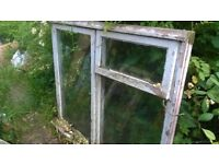 Wooden window frames with glass - could use for cloches or garden projects