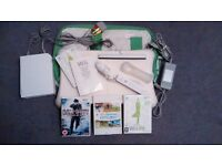 Wii console, Balance Board, games and carry case