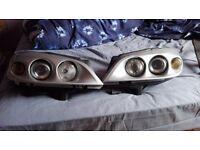 Hella twin headlights for Vauxhall astra
