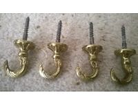 Antique brass ornate hooks / curtain tiebacks in good condition set of four Collect only