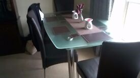 6 seater glass table and chairs