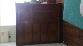 lovely antique chest of draws with deep draws and coat hanging option inside.