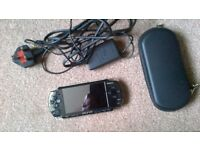 Sony PSP 2000 with charger, case, wrist strap and 10 games on memory stick