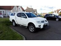Mitsubishi warrior in frost whit 176 bhp model