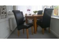 Dining chairs, nearly new.