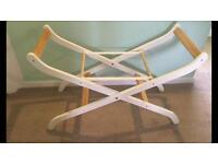 Moses basket and stand for sale.