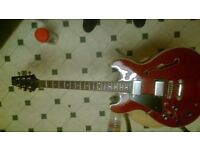 Electric guitar. This is a Aria pro ll in a beautiful red wine colour