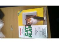 2 x new in box cat flaps for sale
